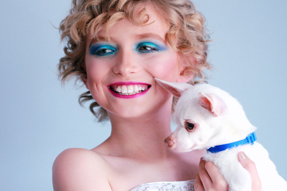 woman in white tube-top dress carrying white chihuahua